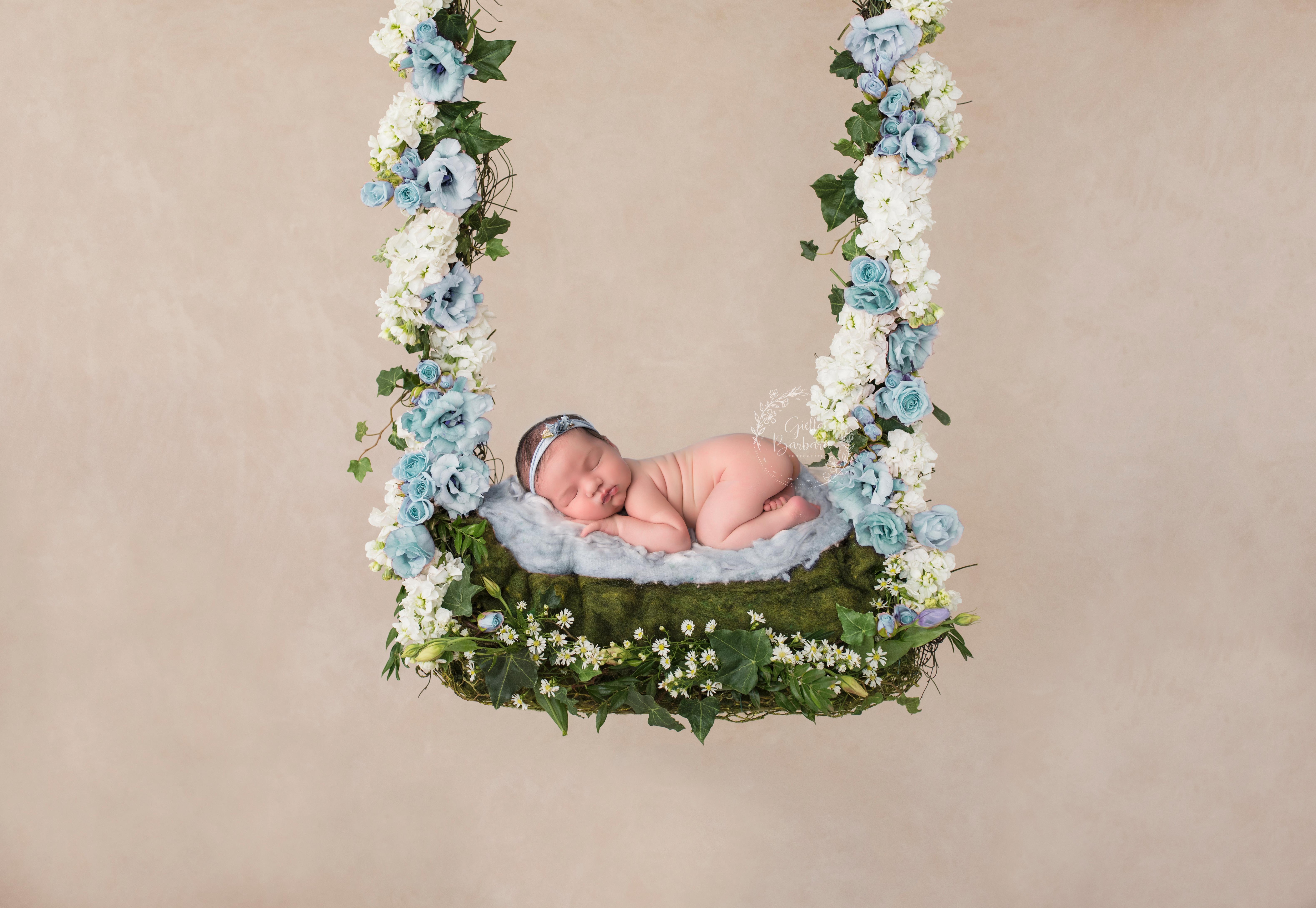 newborn and swing