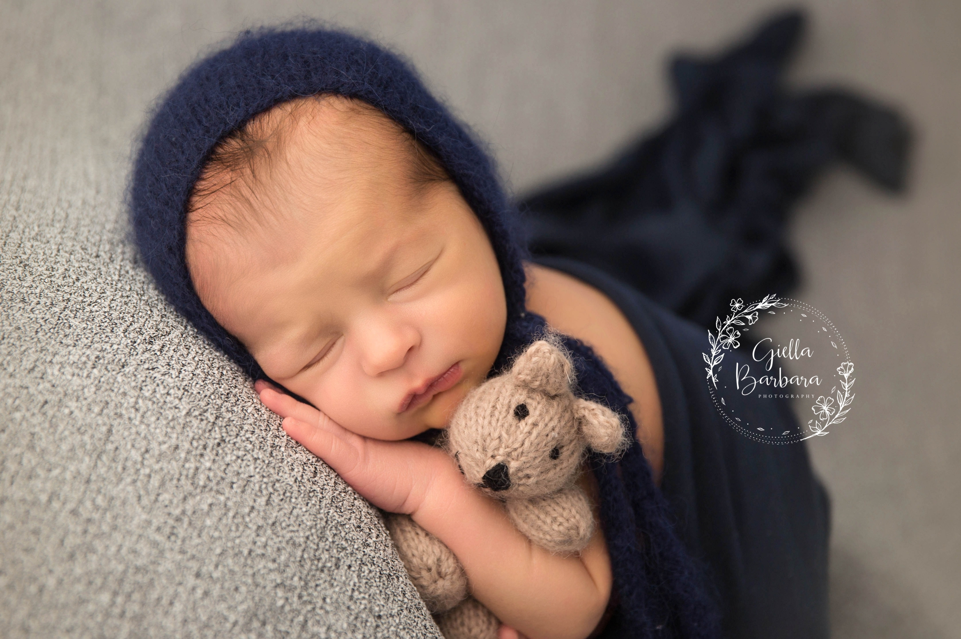 newborn with a teddy