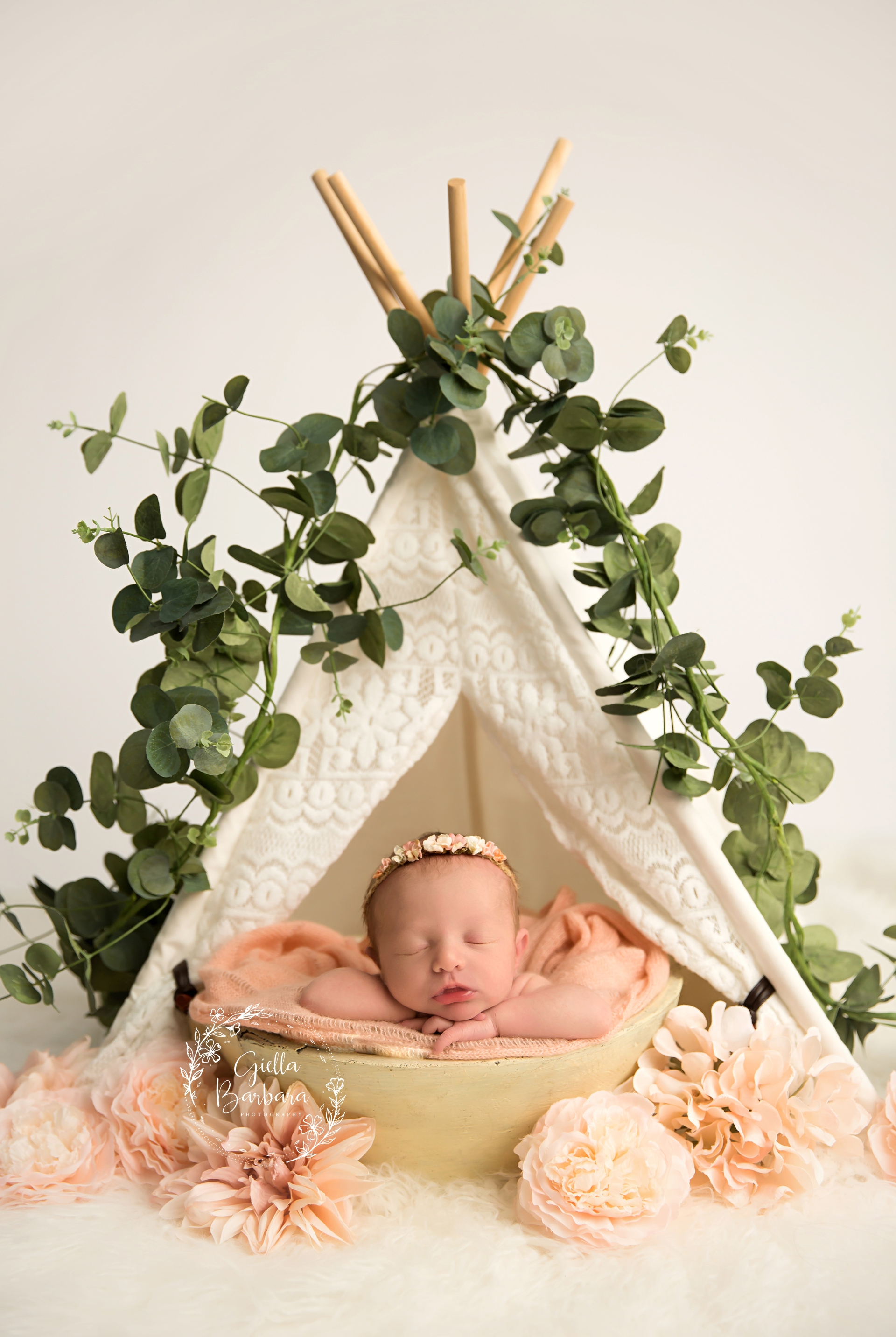 newborn girl in teepee
